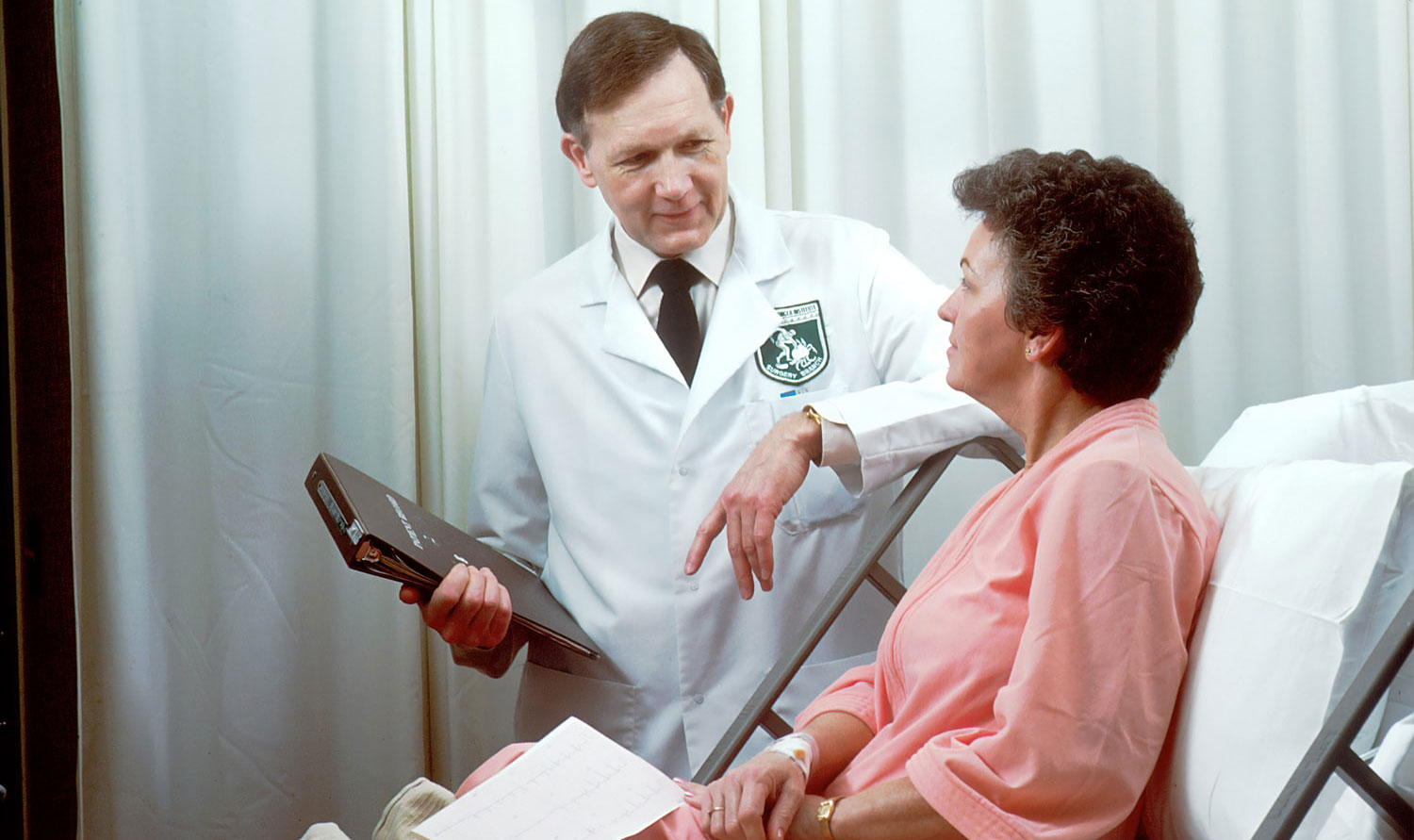 doctor consulting an elderly female patient suffering from constipation